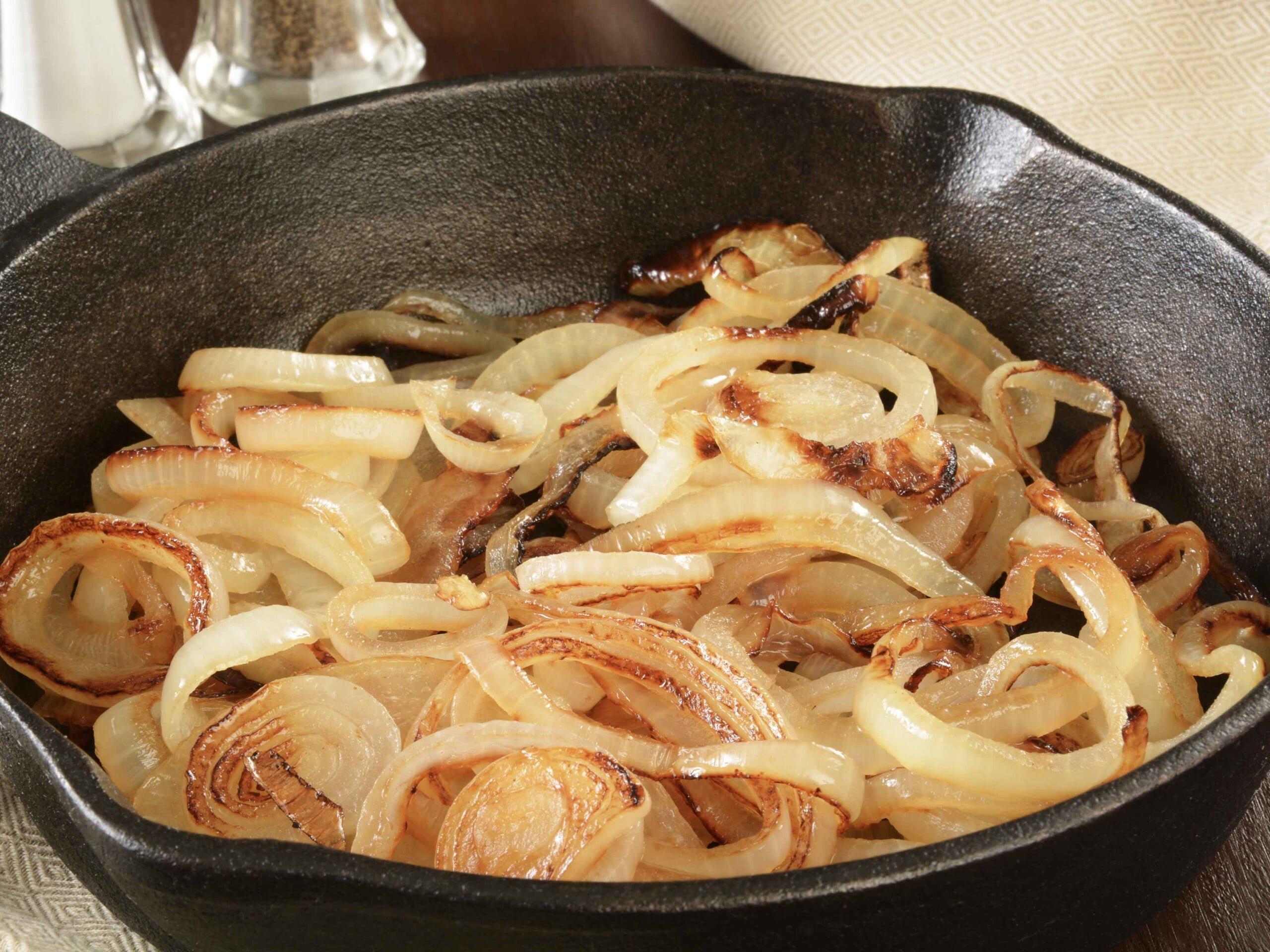 golden onion rings in pan